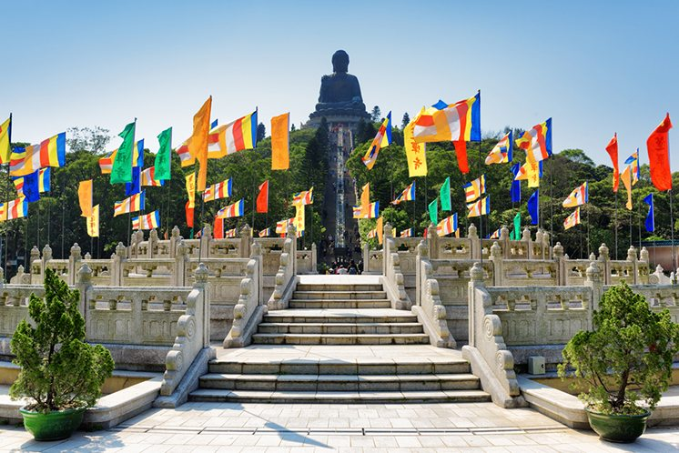 View of Tian Tan Buddha on the blue sky background