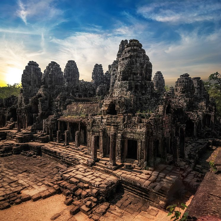 Amazing view of Bayon temple at sunset. Angkor Wat complex, Siem