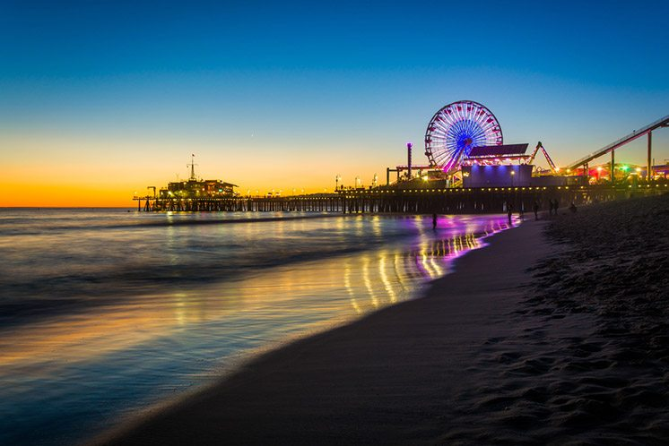 The Santa Monica Pier at sunset, in Santa Monica, California.