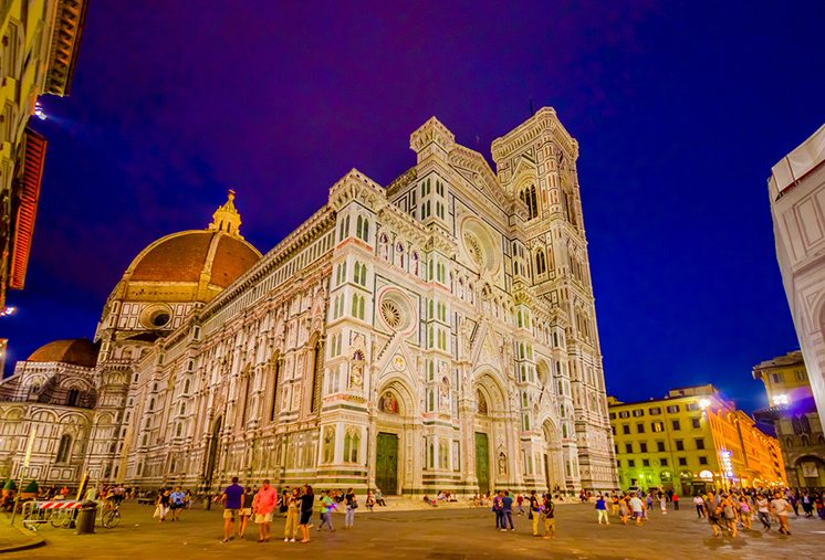 FLORENCE, ITALY - JUNE 12, 2015: Sunset in front of Florence Cathedral, blue sky contrasts and luminated building