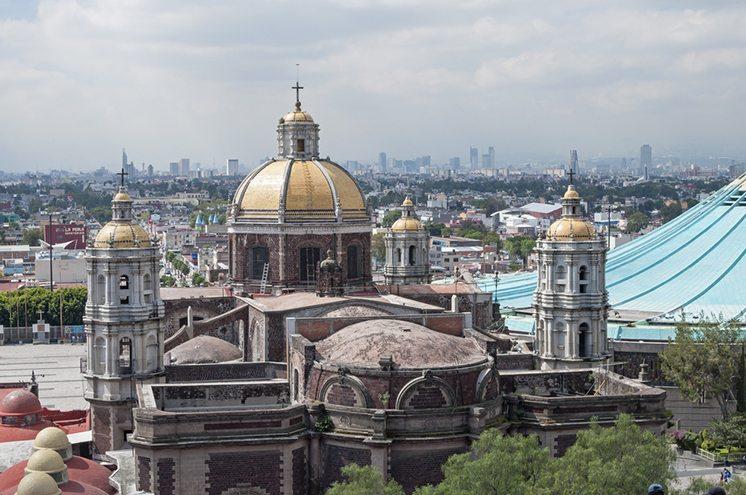 Basilica and skyline of Mexico City