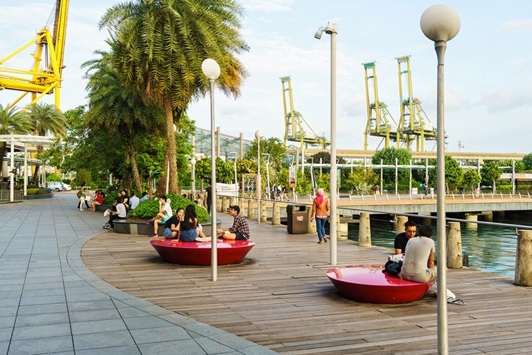 Tourists at Sentosa Boardwalk leading from Singapore Mainland to