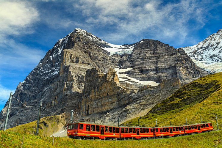 Electric tourist train and Eiger North face,Bernese Oberland,Swi