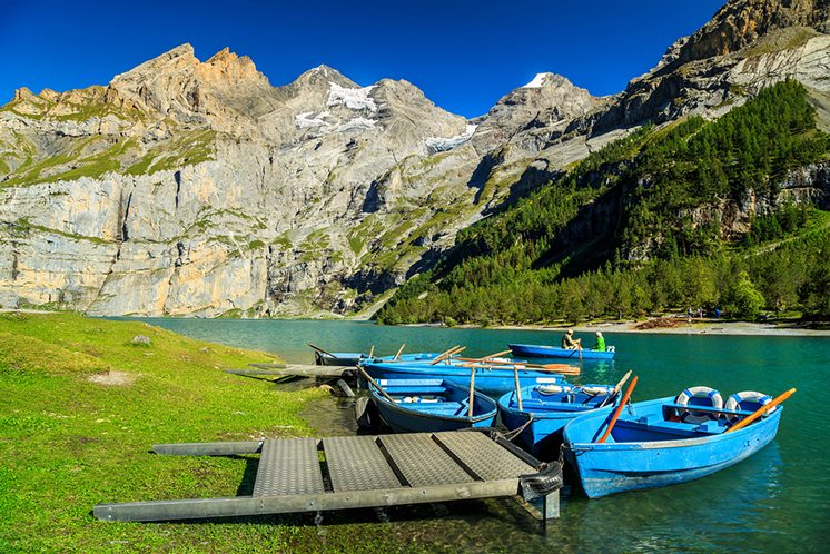 Wonderful alpine lake with high mountains and glaciers,Oeschinen